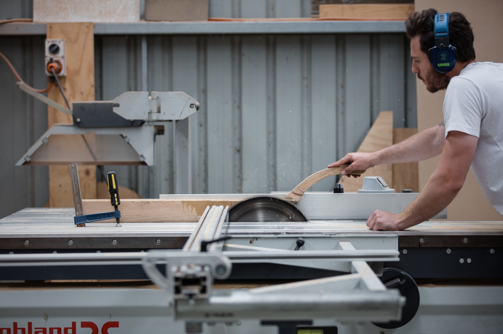 Action Shot of Daniel Poole on the Panel Saw - Woodworker and maker of the month - the local project