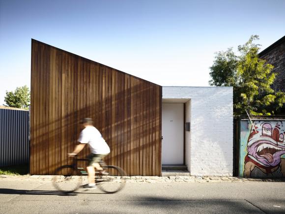 datum house by RKA - exterior timber panelling against white bricks