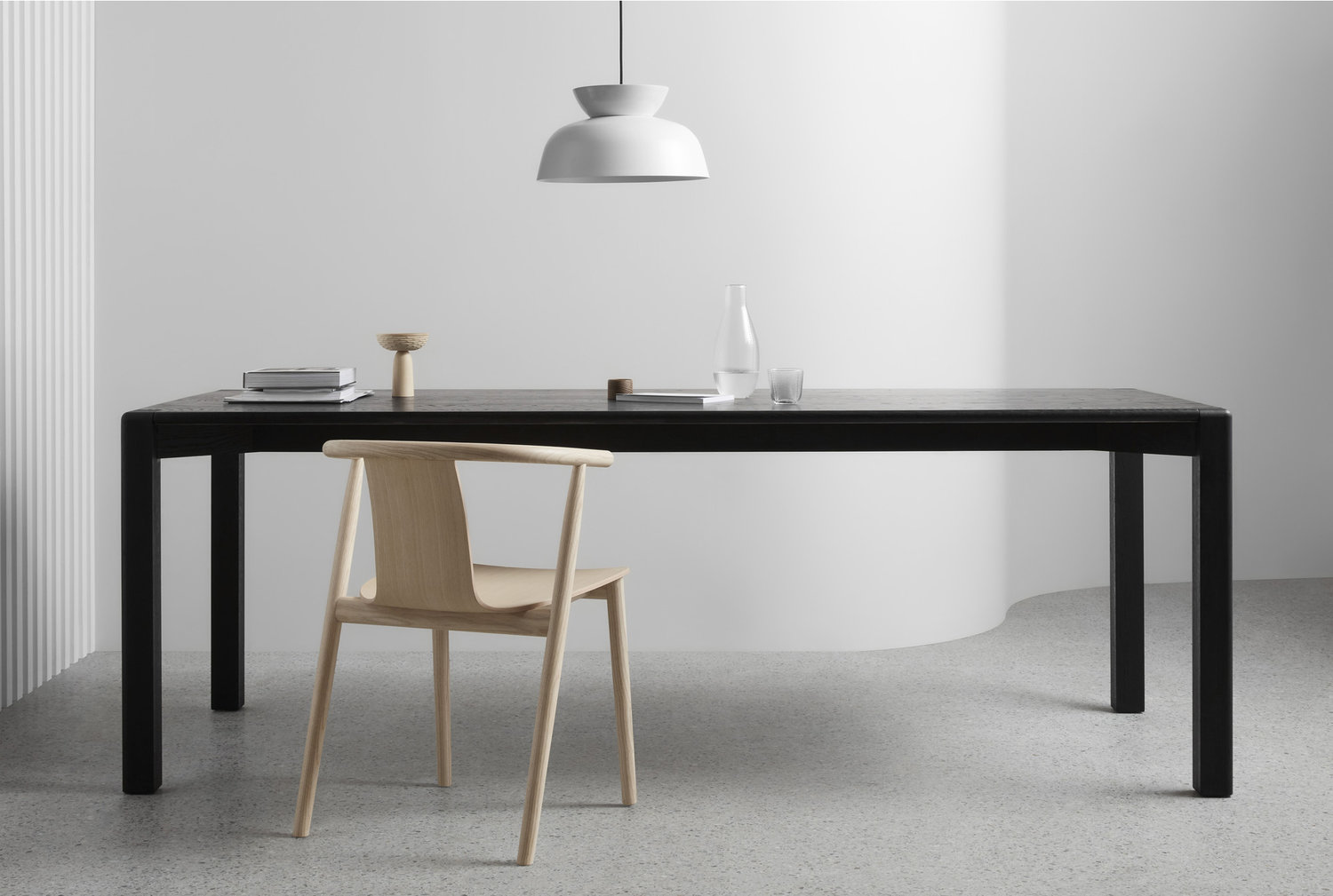 The AOD – T American Oak Timber Dining Table by Brunswick–based Victorian furniture designer Made by Morgen. The timber finish comes in natural or black.
