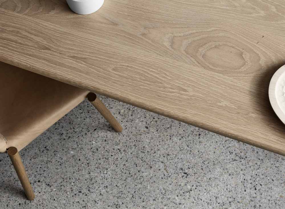 The timber dining table is customisable and available in range of finishes, dimensions and materials