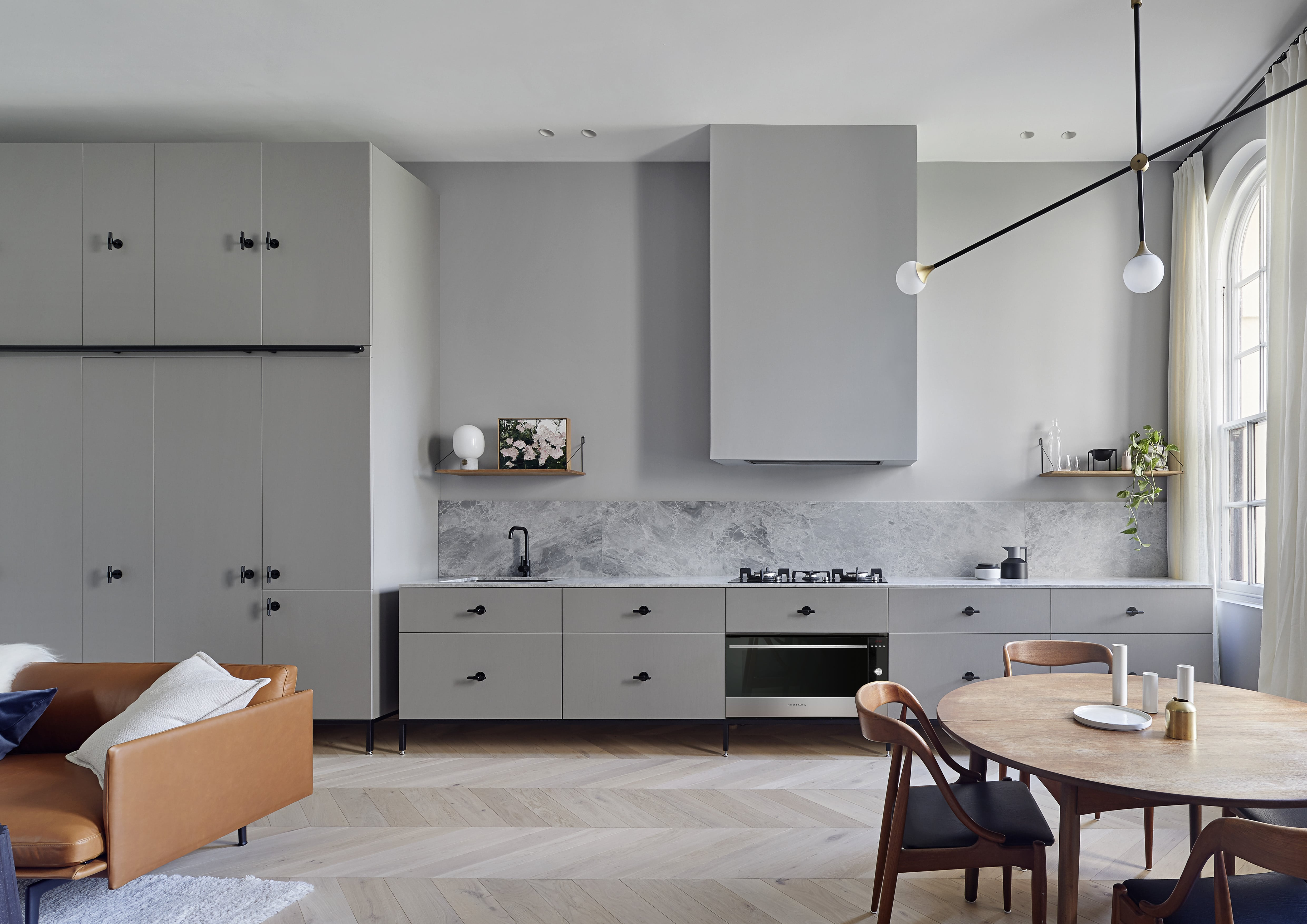 Kitchen of the Kew Apartment by Sarah Wolfendale - Integrated Fisher & Paykel Appliances