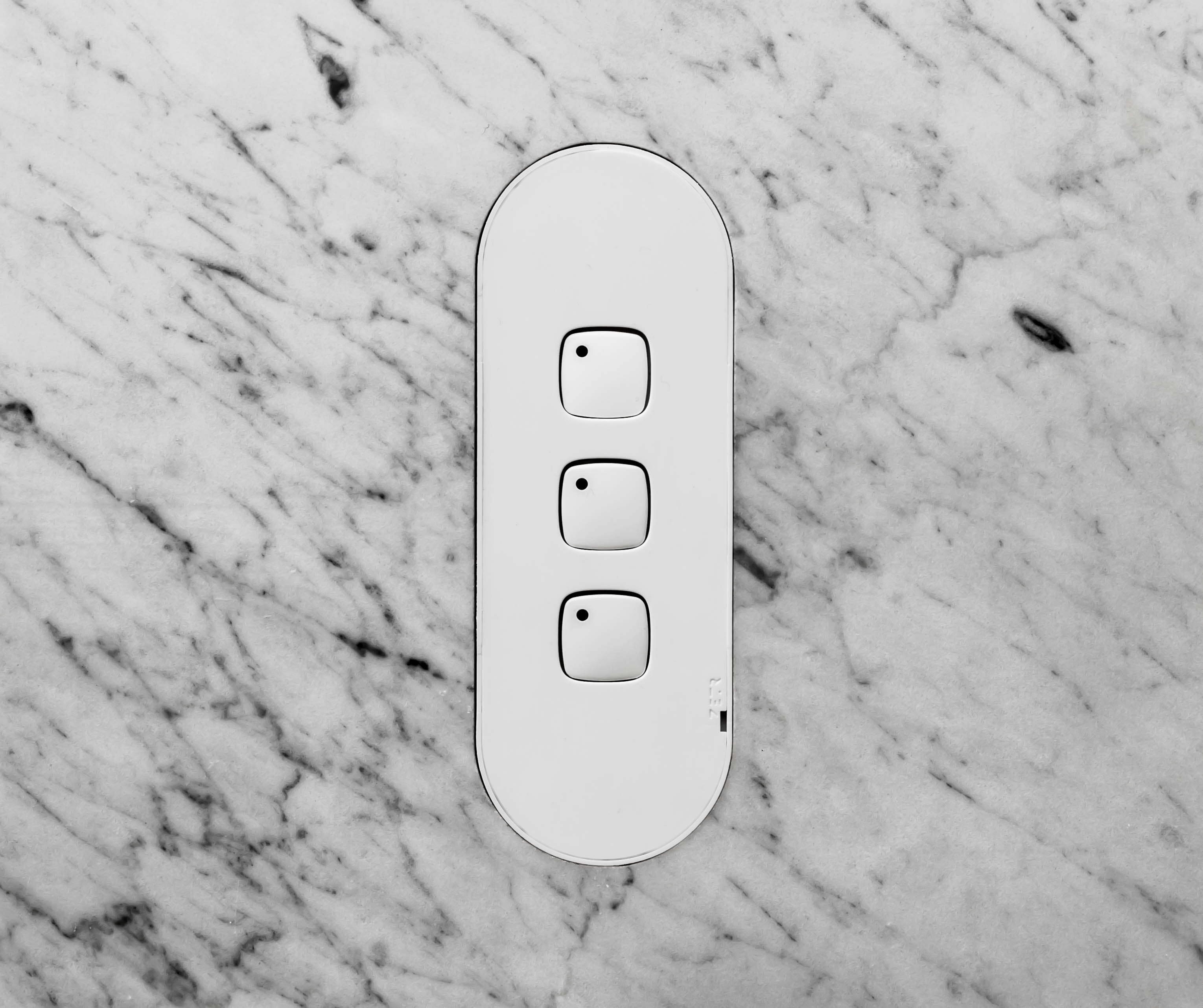 Zetr 13 3f W. Three Gang Switch In White With Adjustable Mounting Assembly Finished In Marble