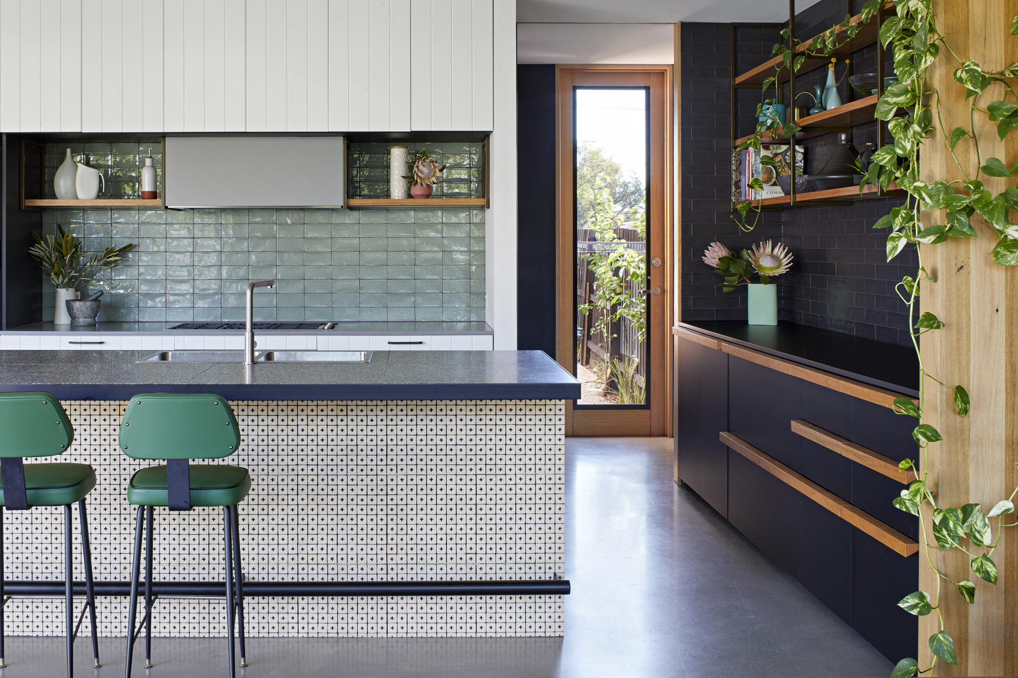 By Separating The Addition From The Original Home With A Courtyard