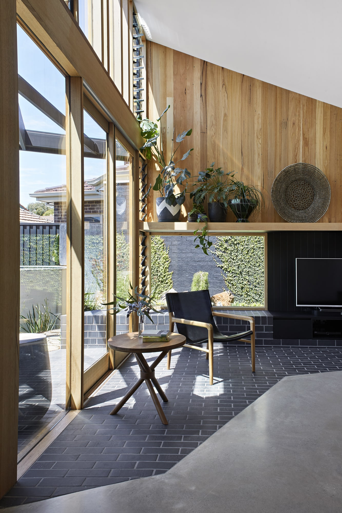 While A Separate Living Area In The Front Room Takes Advantage Of The Existing Corner Windows And A Feature Fireplace.