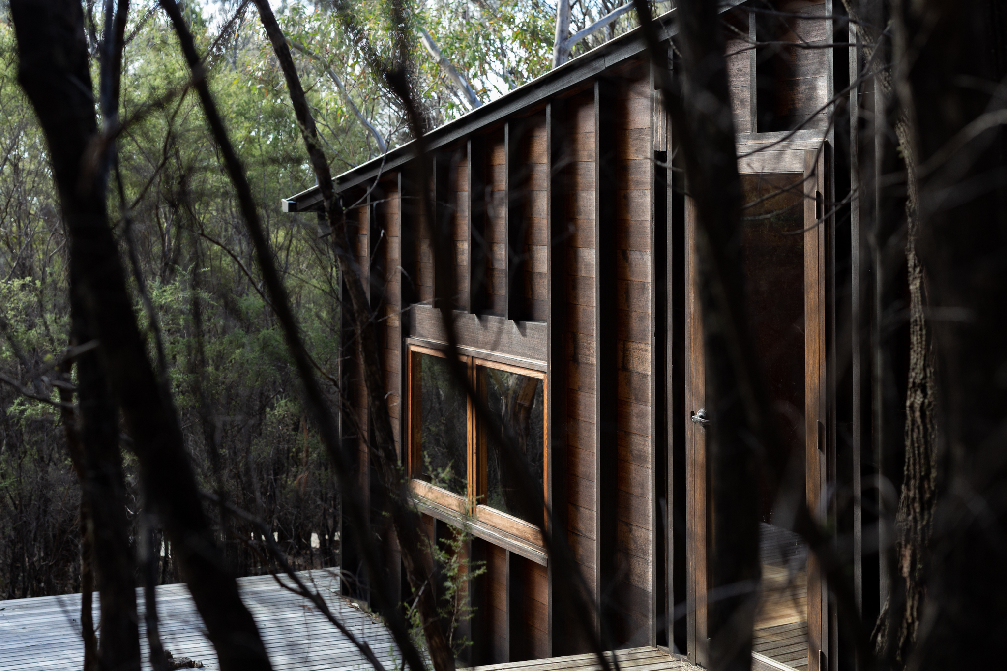 Comprising Of Primarily Tasmanian Sourced Timber, The Almost Charred Appearance Of The Hut Camouflages The Structure From The Approaching