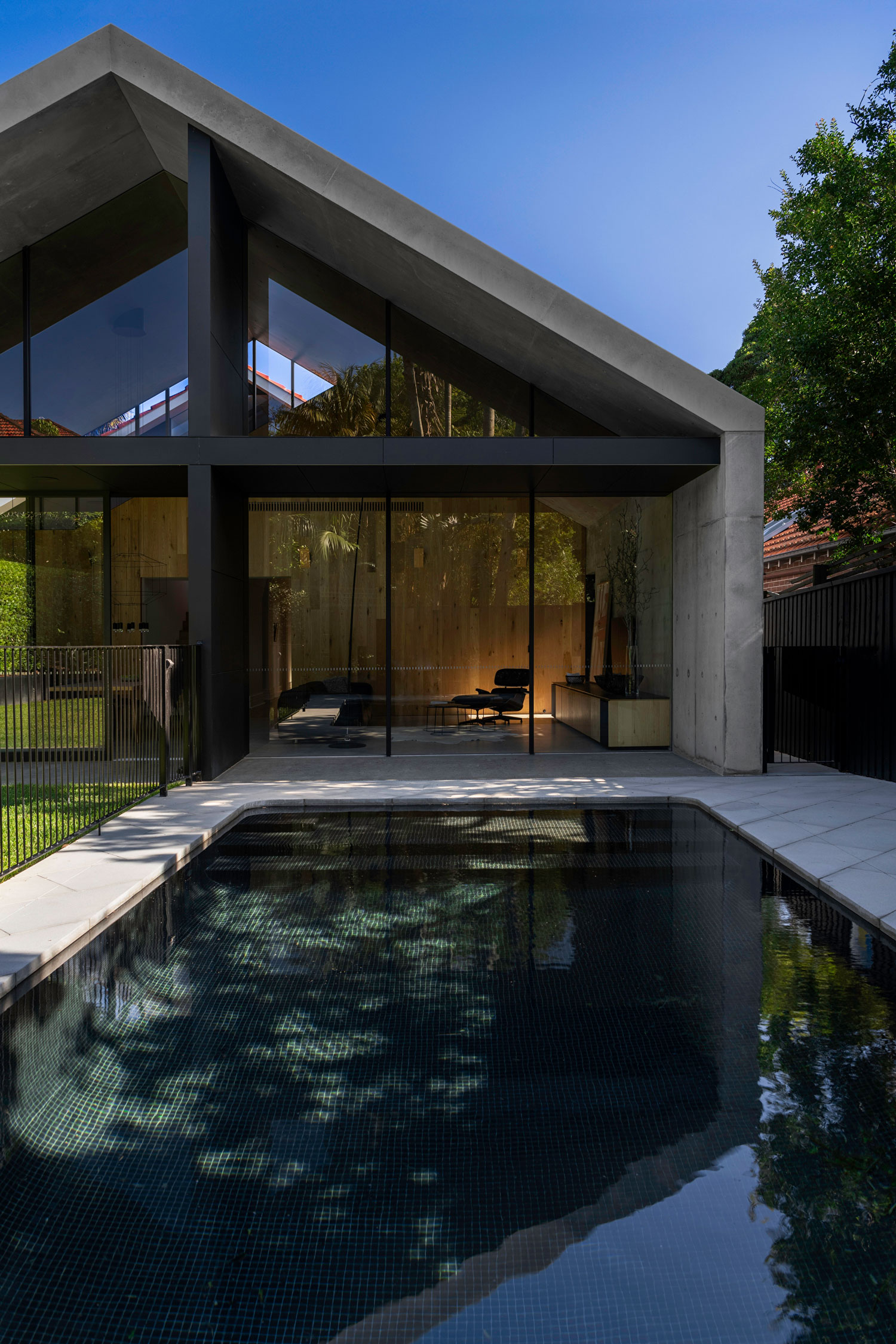 The New Concrete Shells Also House A Timber Clad Wall Which Represents The Line Of The Old Home